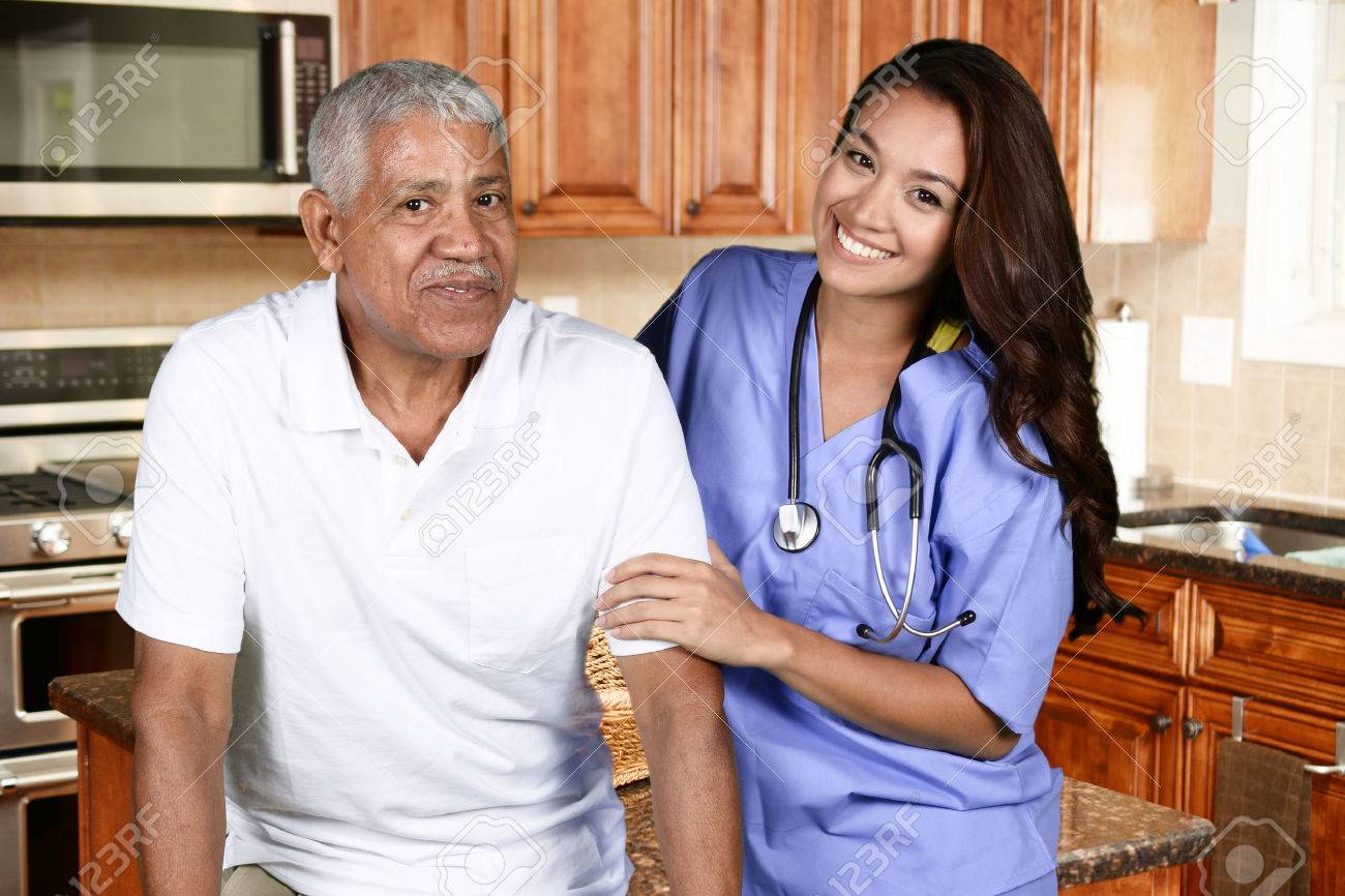 Home health care worker and an elderly man Stock Photo - 45930398