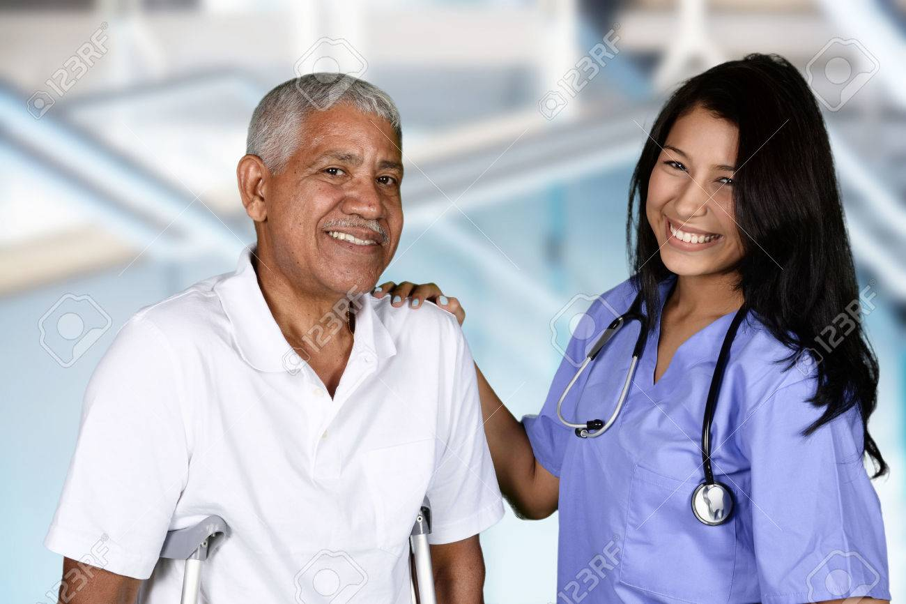 Nurse giving physical therapy to an elderly patient Stock Photo - 45930401