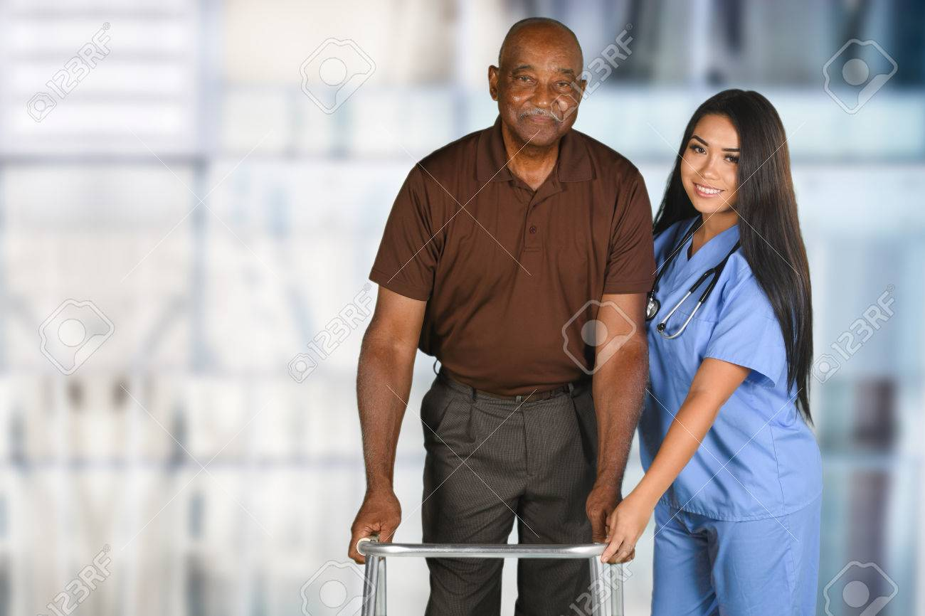 Health care worker helping an elderly patient Stock Photo - 62452096