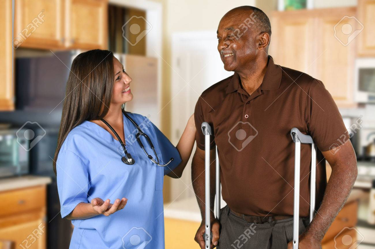Health care worker helping an elderly patient - 62452162