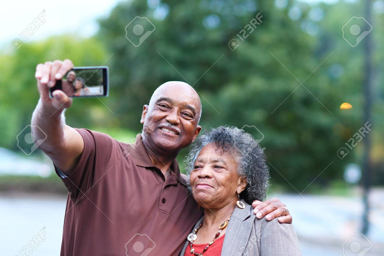 Elderly African American Man and woman posing together - 62452169