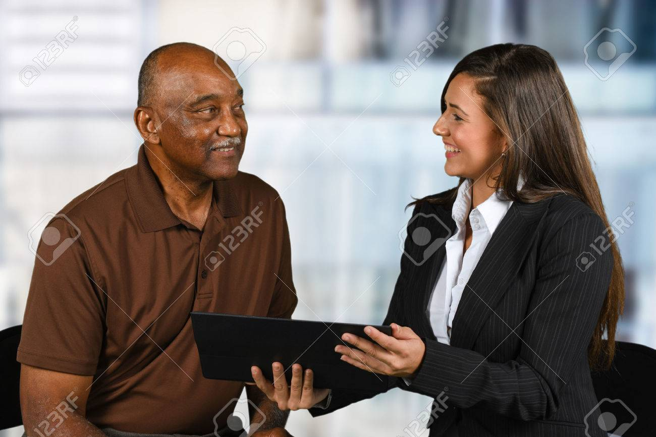 Confident businesswoman who is working with an elderly client - 62452179