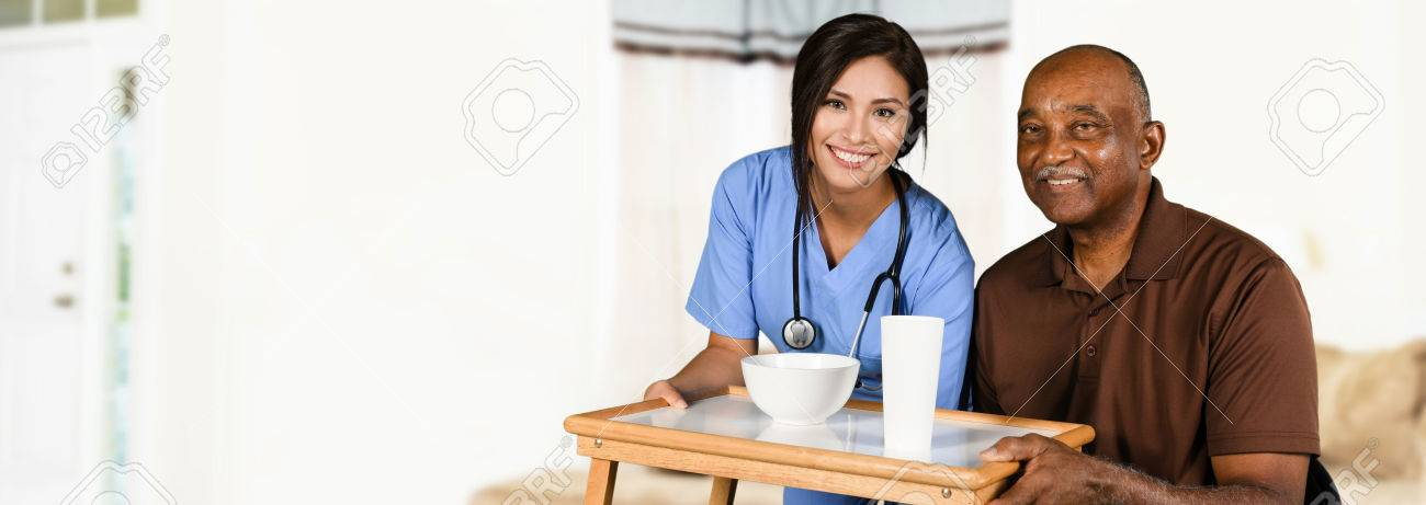 Health care worker helping an elderly patient Stock Photo - 62452298