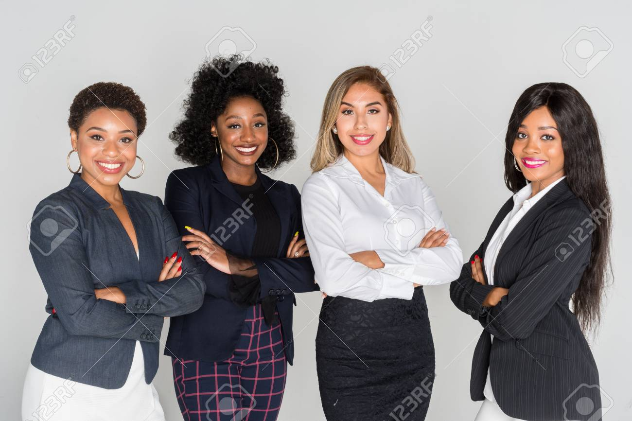 Group of businesswomen working together in an office - 104069386