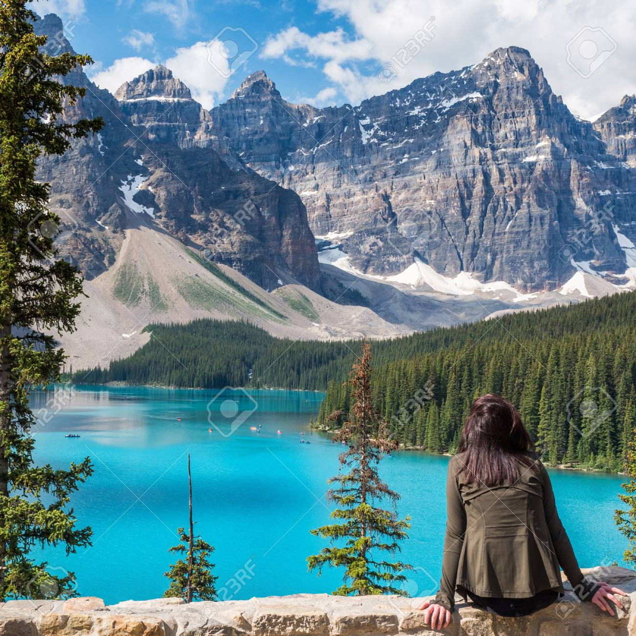Tourist At Moraine Lake In Banff National Park Alberta Canada