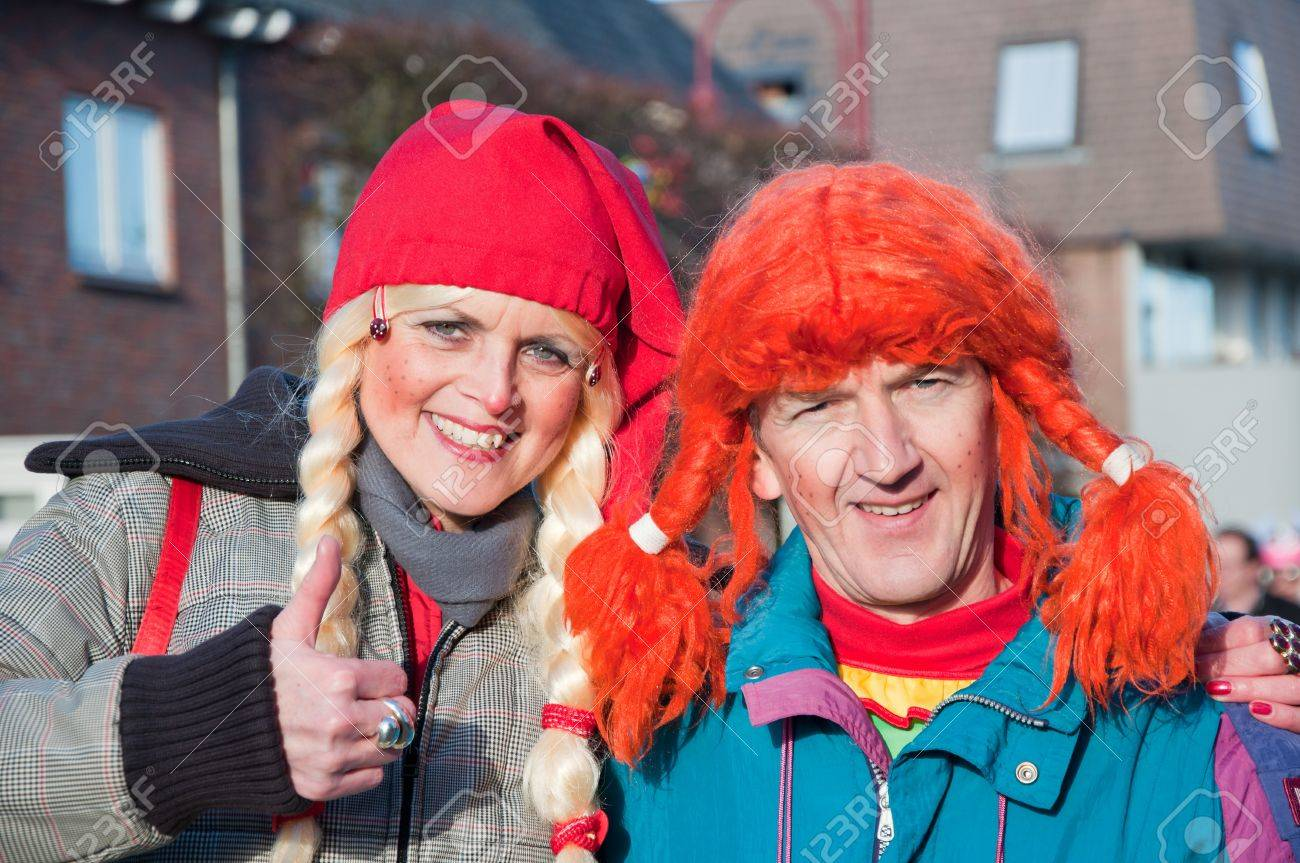 Made, North-Brabant, Netherlands – March 6, 2011 - Dutch carnival on the streets of a small village, costumed man and woman Stock Photo - 9012735