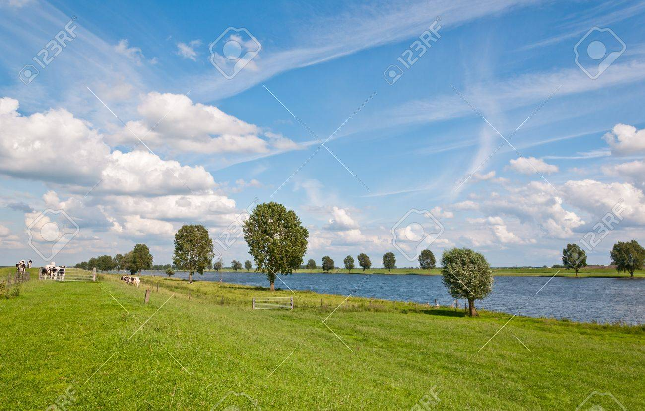 A typical Dutch landscape with grass, clouds and a river Stock Photo - 9885599