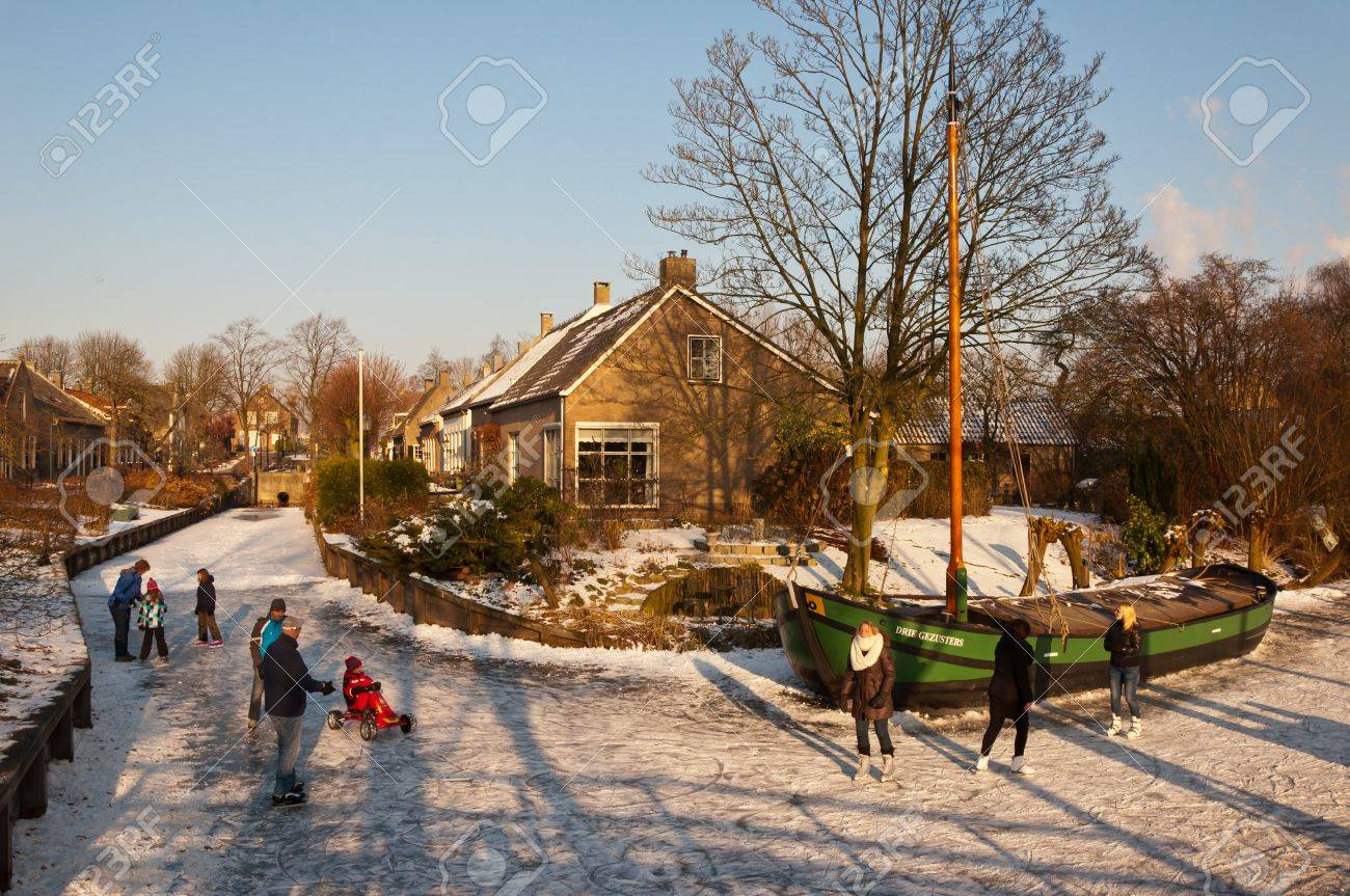 Drimmelen, North-Brabant, Netherlands, February 10, 2012,  On the ice of the frozen canal of the small Dutch village of Drimmelen Stock Photo - 12316248