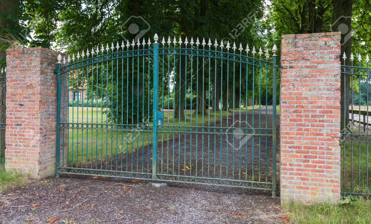 wrought iron fence brick. Green Wrought Iron Gate Between Two Masonry Brick Pillars Stock Photo - 21264971 Fence