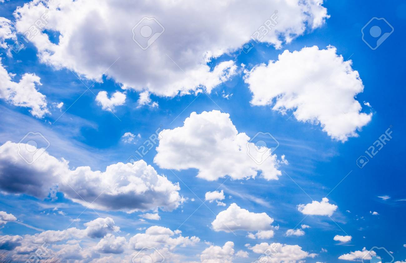 cumulus clouds with clearly defined edges against a deep blue