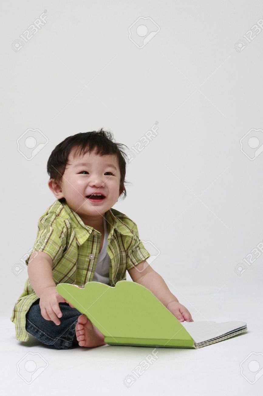 Cute toddler holding a book Stock Photo - 11575614