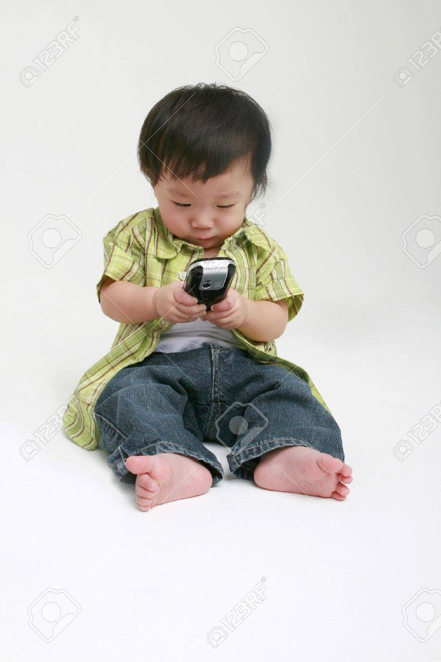 Cute toddler with a mobile phone Stock Photo - 11772101