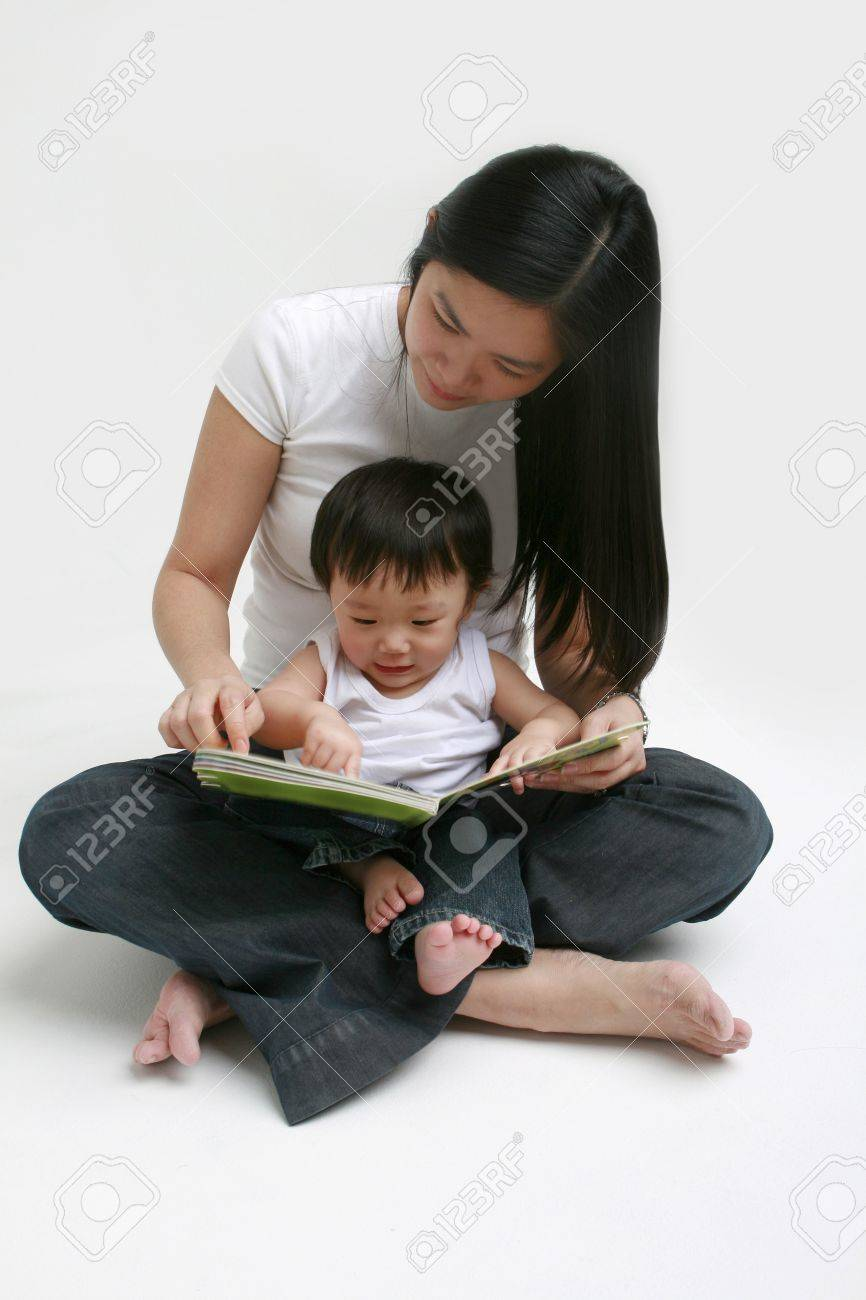 Woman and child looking at a book Stock Photo - 11789257