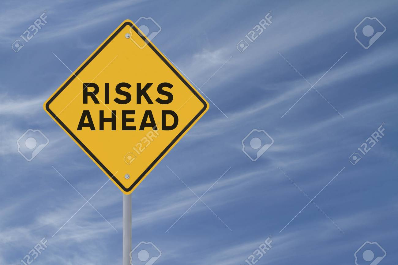 Risks Ahead sign on blue sky background Stock Photo - 13764686