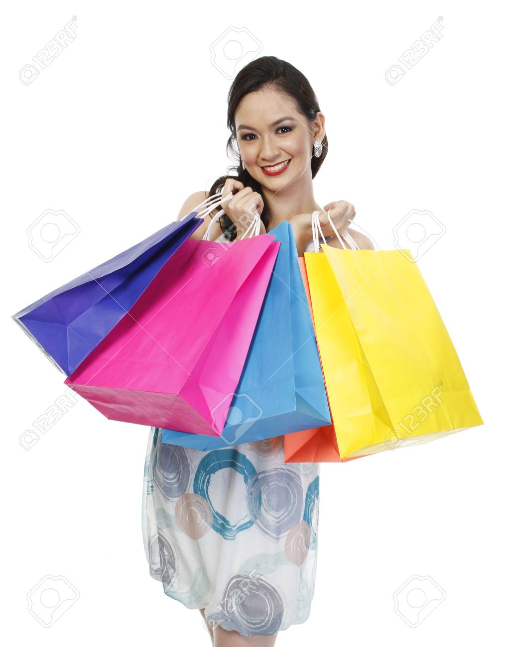 An attractive fashionable woman holding colorful paper shopping bags (isolated on white) Stock Photo - 14796983