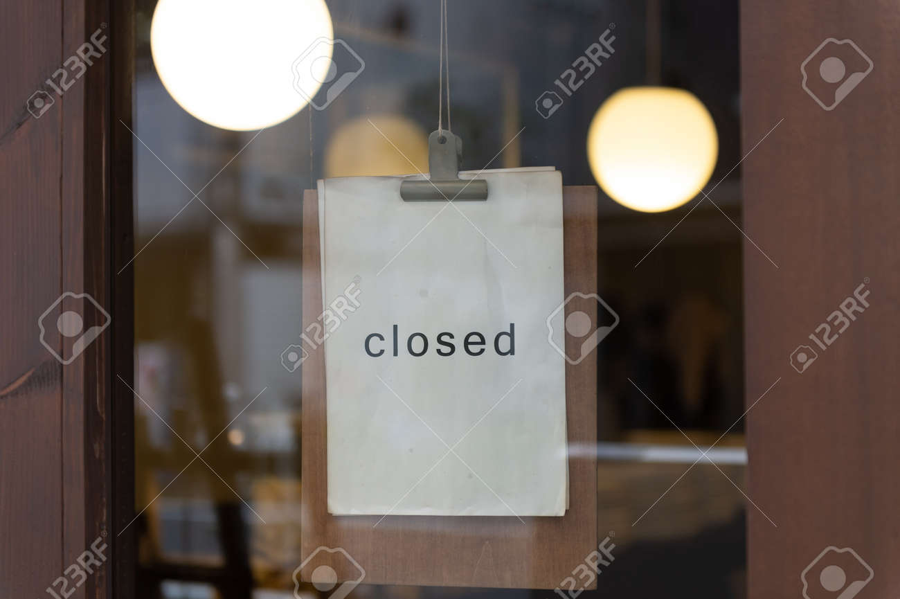 Closed sign in a shop - 121081423