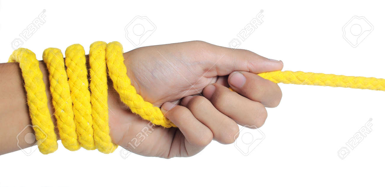 hand was pulling yellow rope - 7804662