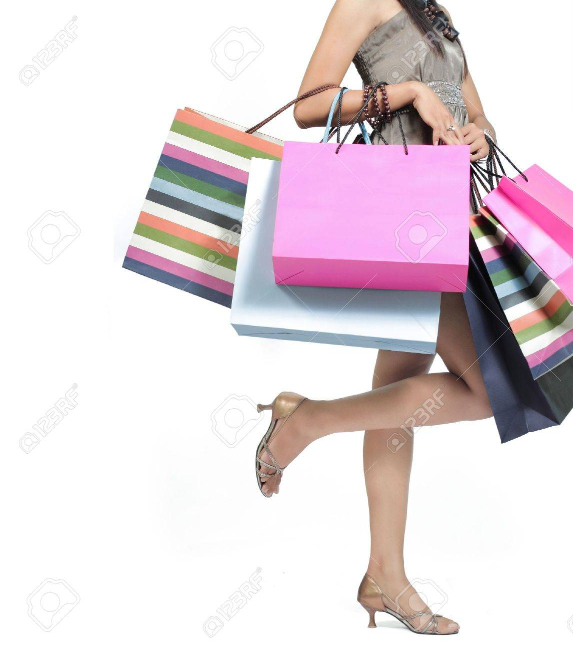 Beautiful woman with a lot of shopping bags Standard-Bild - 9204042