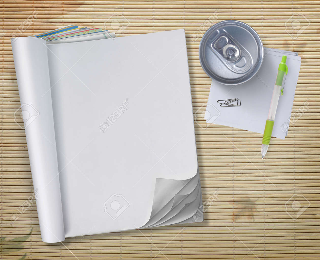 conceptual blank book with soda can and pen over wooden background Standard-Bild - 9204201