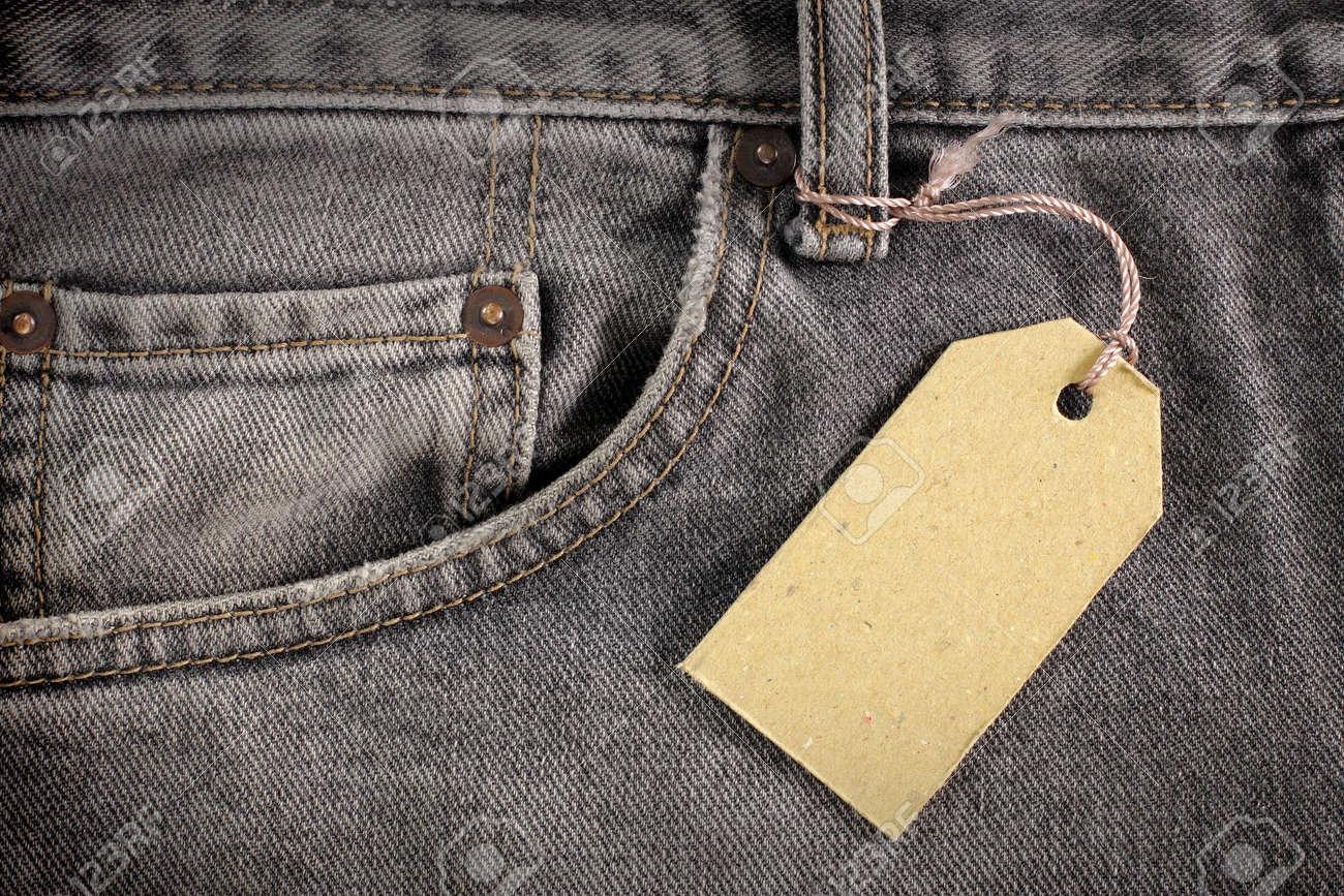 denim jeans background with price tag Standard-Bild - 9469597