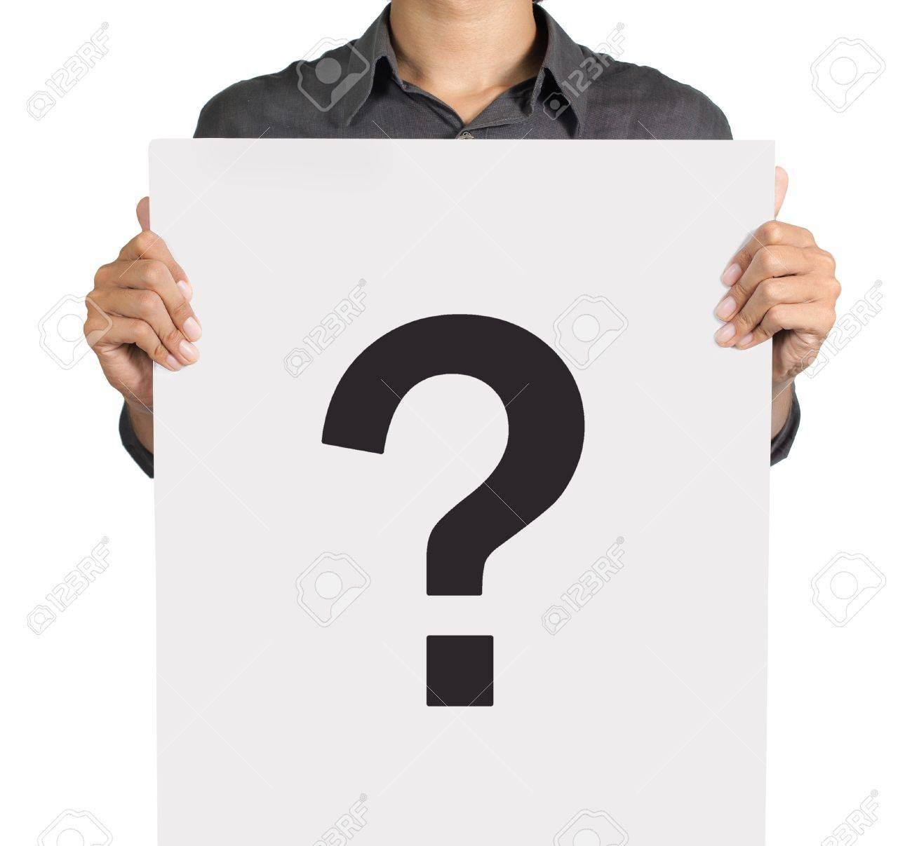 Young man standing with question mark on white board Standard-Bild - 9469477