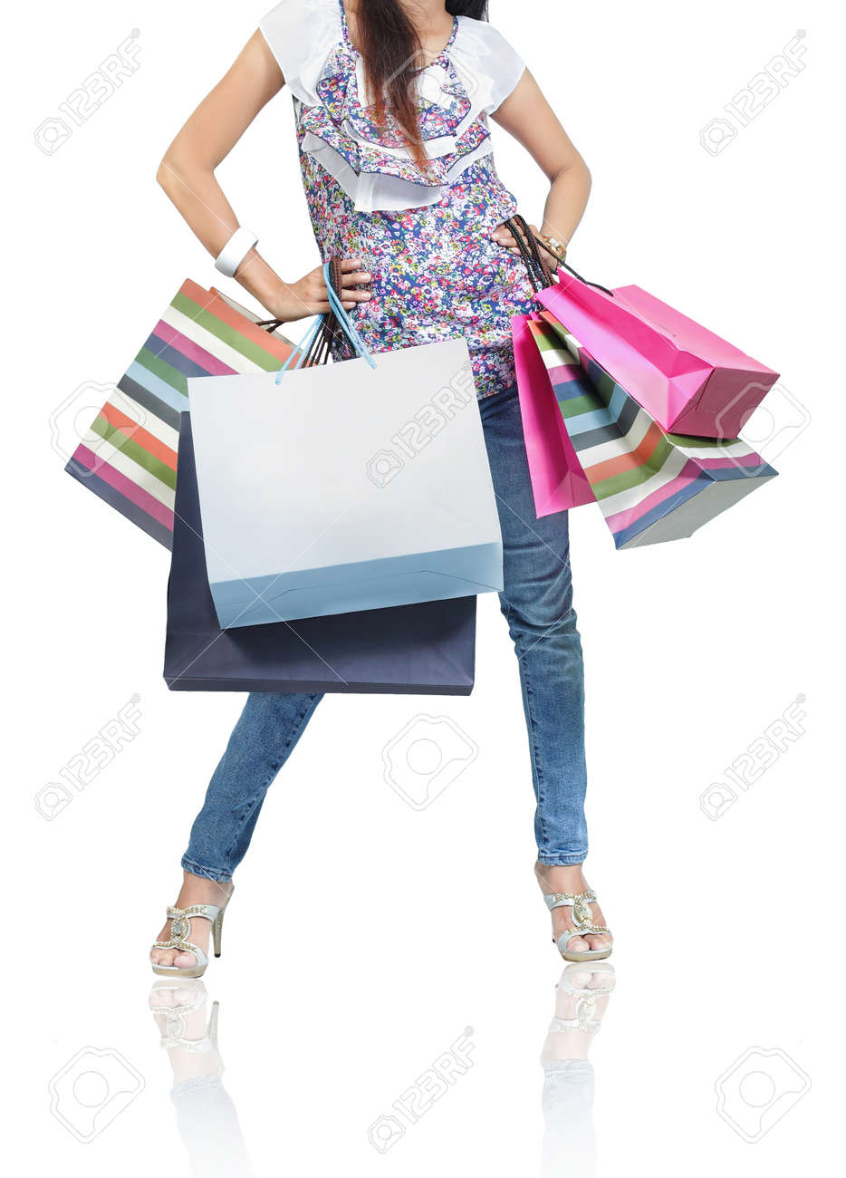 Beautiful woman with a lot of shopping bags Standard-Bild - 9607721