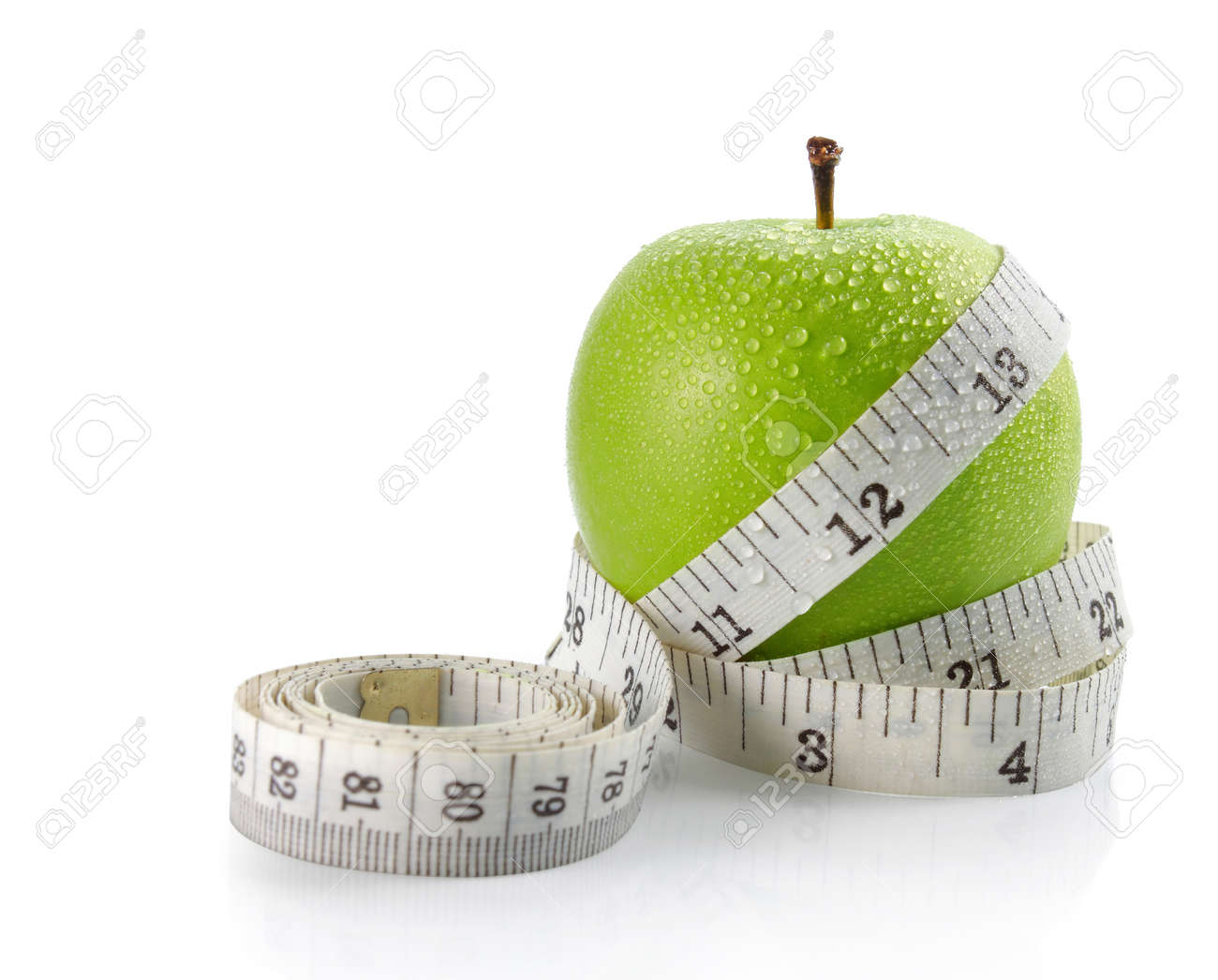 fresh apple with measuring tape. isolated over white background Standard-Bild - 9607729