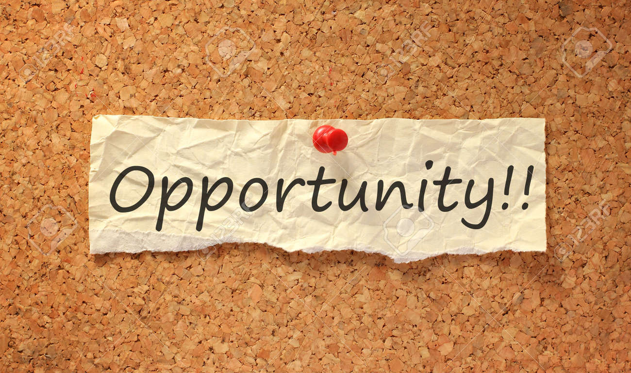 opportunity sign on corkboard attached with thumbtack Standard-Bild - 9848815