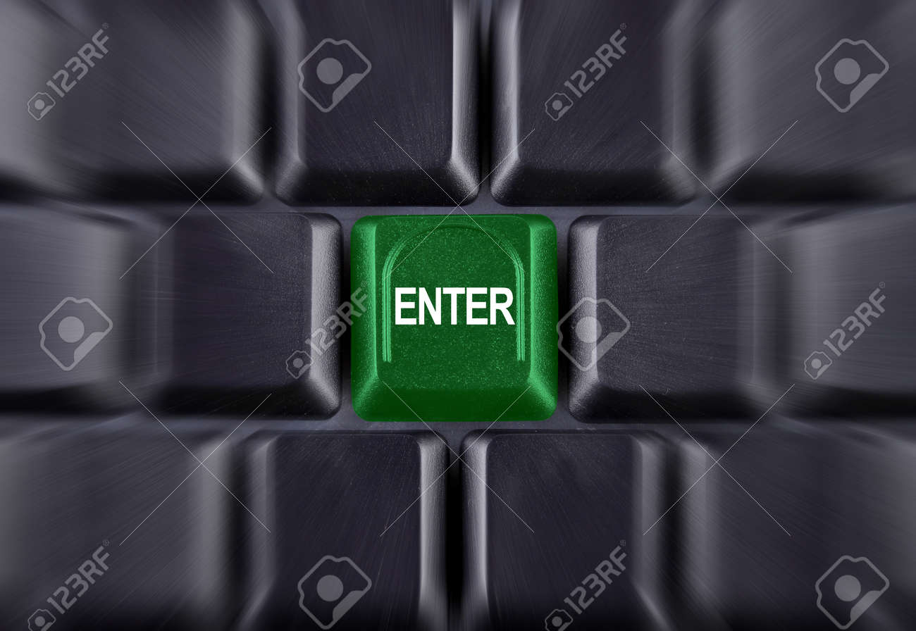 green enter button on black the keyboard Stock Photo - 10538970