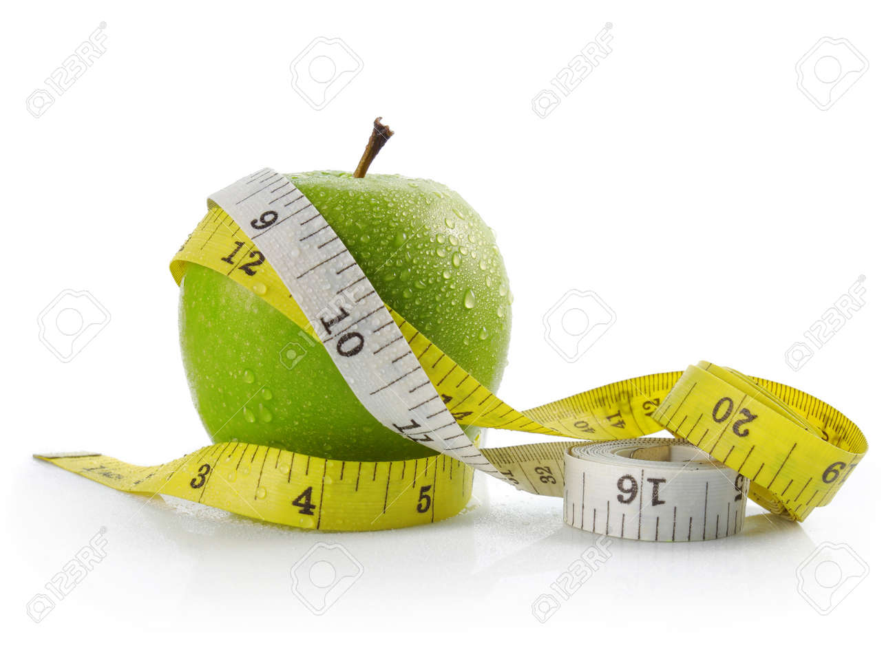 fresh apple with measuring tape. diet concept, loss weight Standard-Bild - 11154457