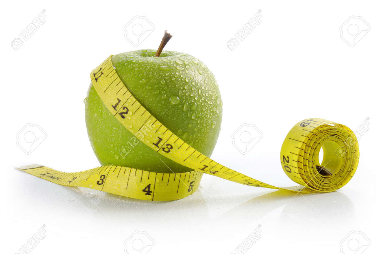 fresh apple with measuring tape. diet concept, loss weight Standard-Bild - 11154450