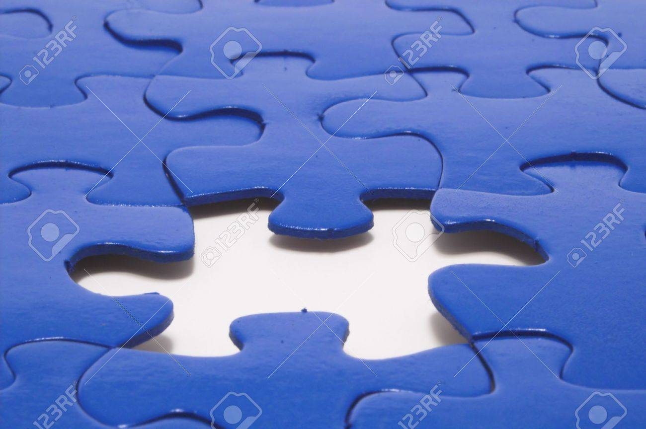 A close-up of a jigsaw puzzle with a missing puzzle piece. Stock Photo - 922987