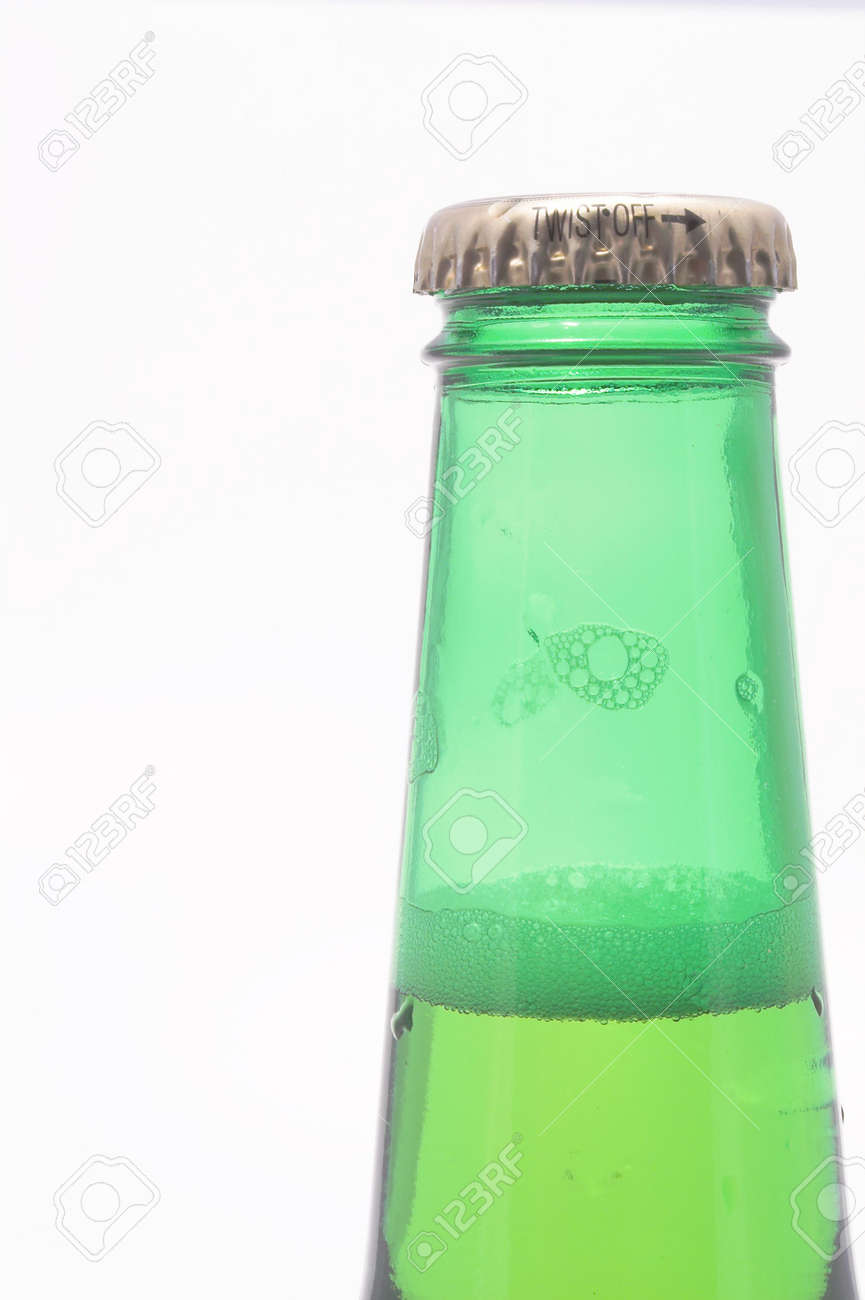 A delicious cold beer in a green bottle. Stock Photo - 945100