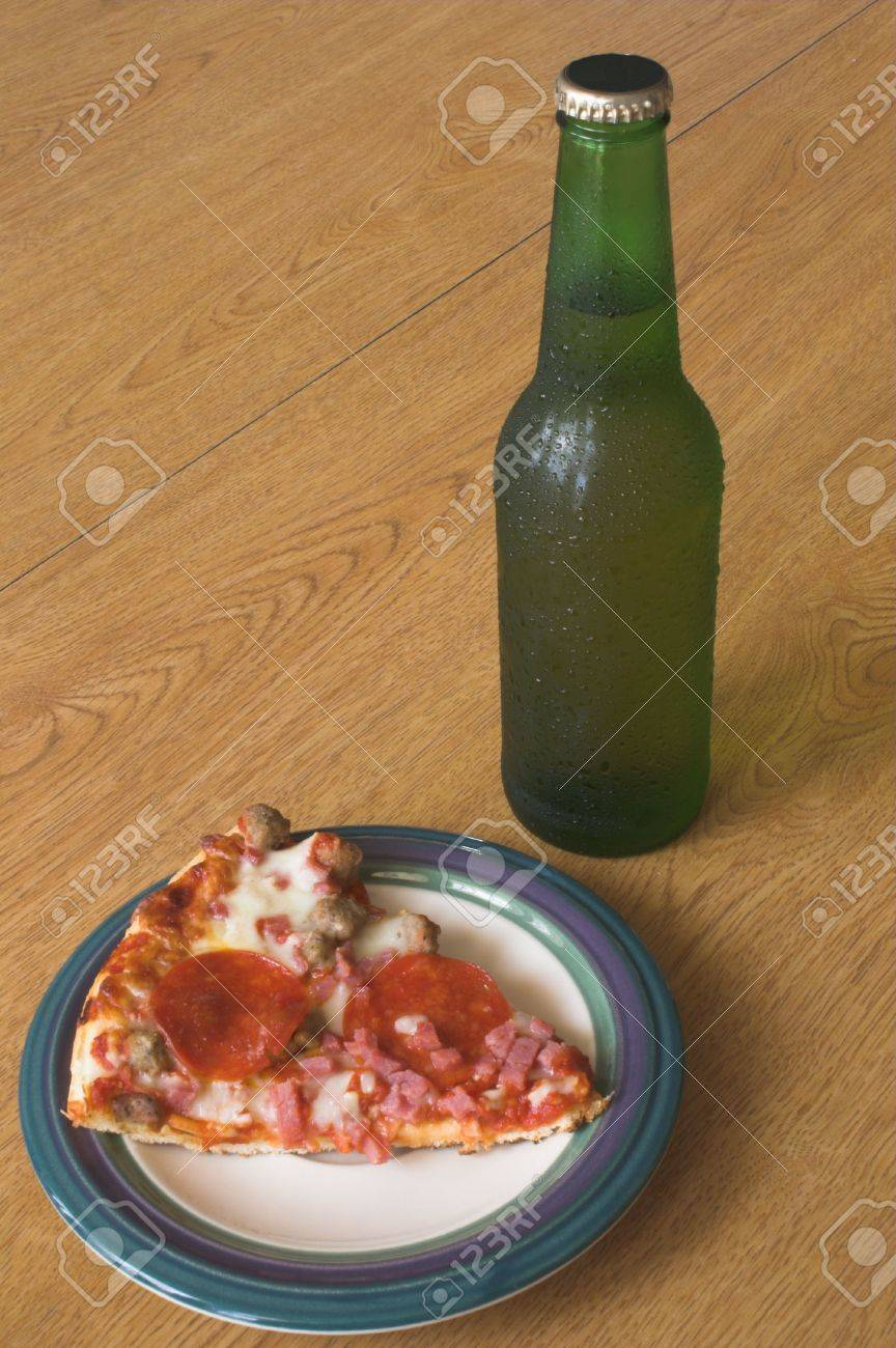 A slice of pizza and a beer in a longneck bottle. Stock Photo - 954148