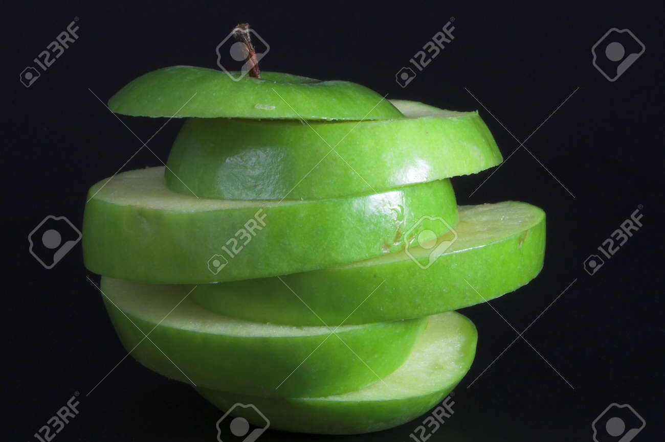 A sliced green apple in a stack. Stock Photo - 1335335