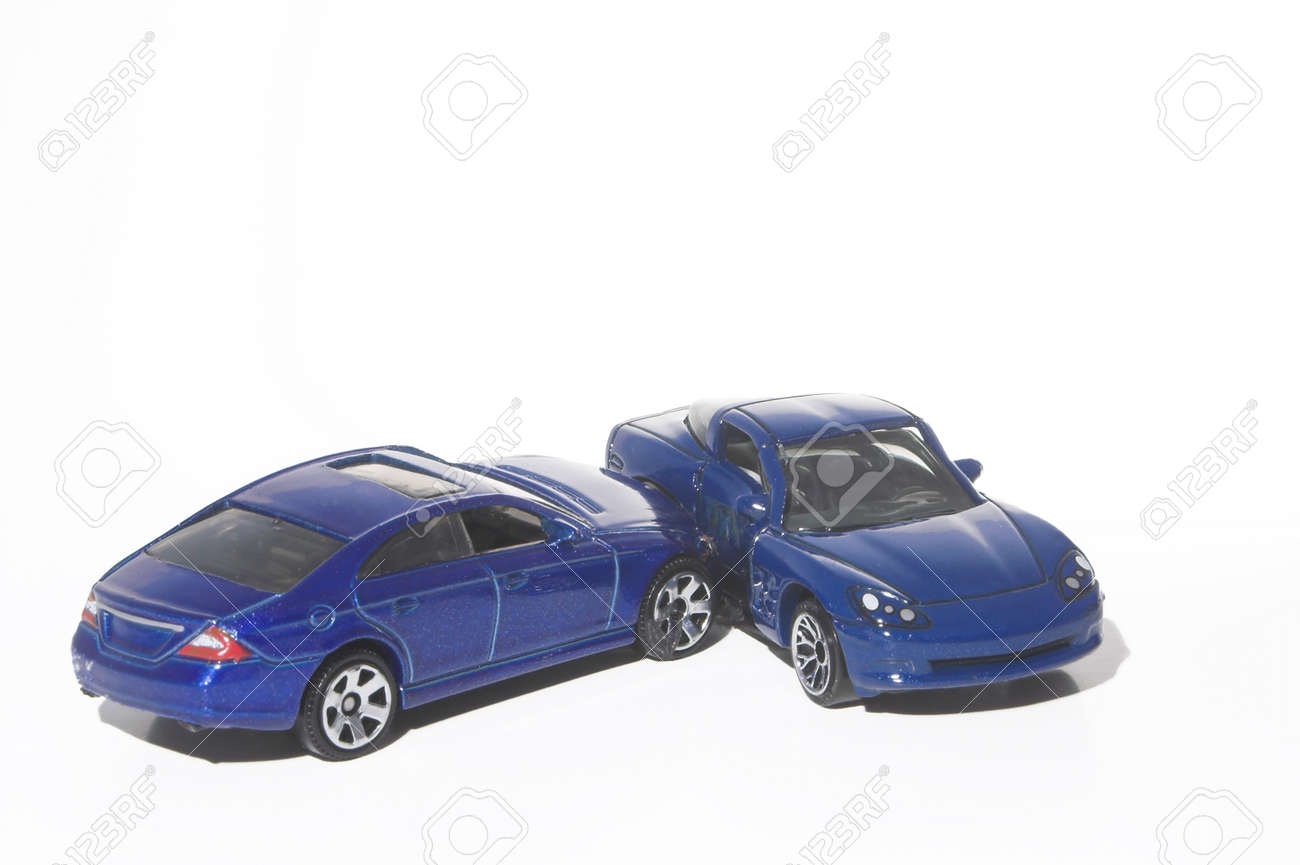 a car wreck involving two miniature toy cars stock photo 1491918