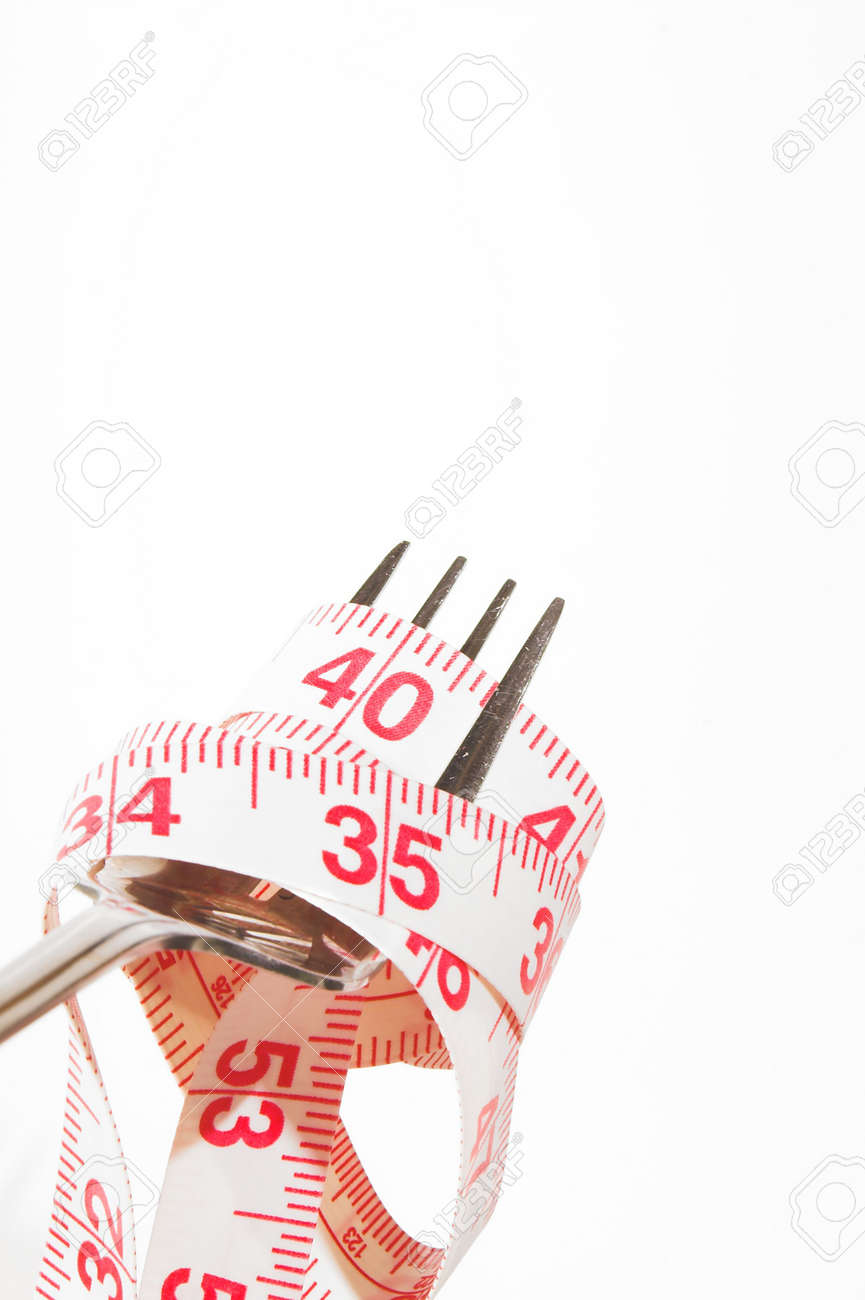 Weight Loss Concept - A tailor's tape on a fork. Stock Photo - 2232670