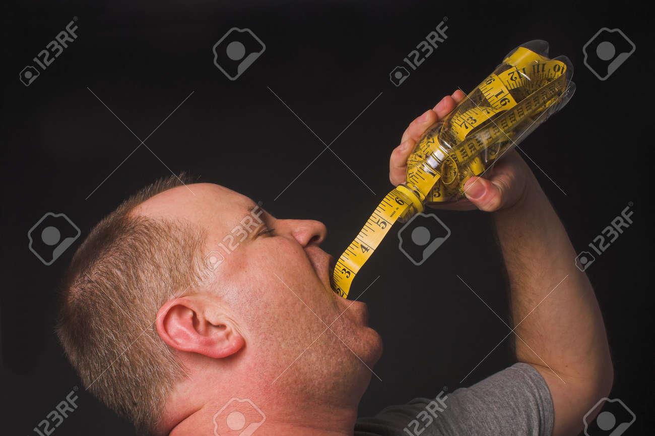 A man enjoying a beverage. Diet drink concept. Stock Photo - 2691709