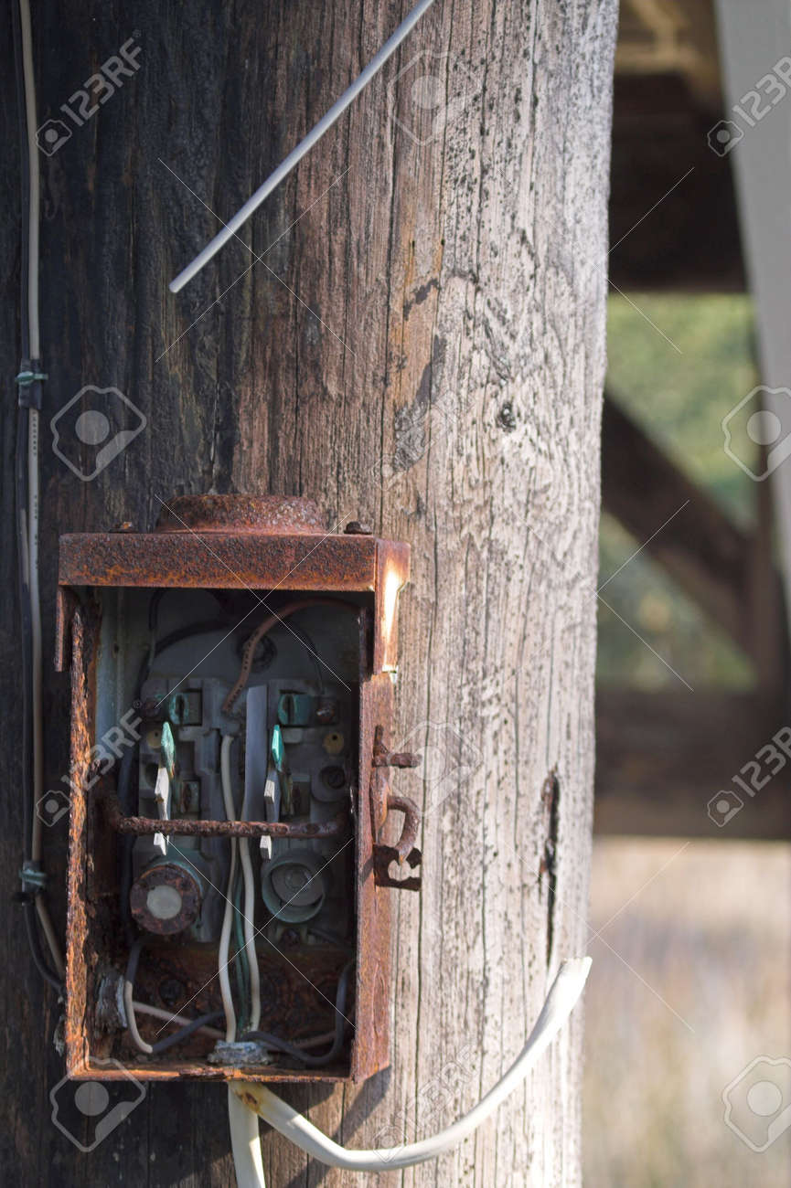 An old electrical box on a telephone pole