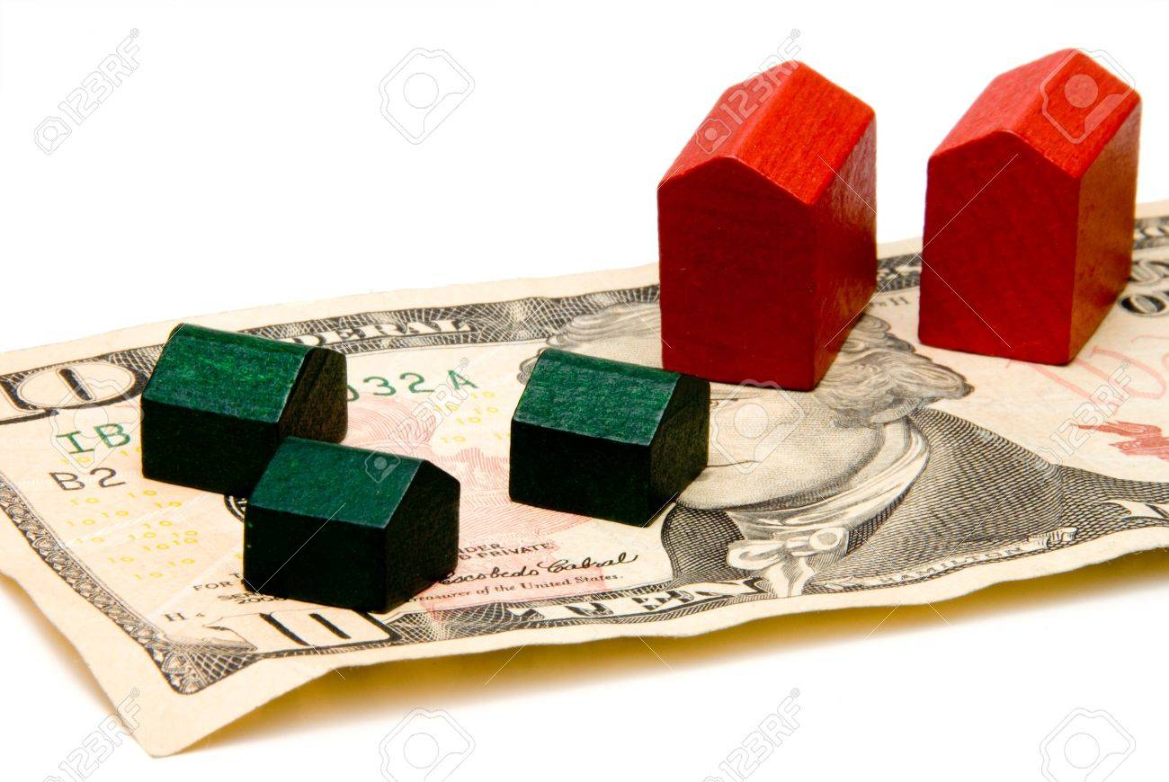 Houses and hotels built on a cash foundation. Stock Photo - 3709792