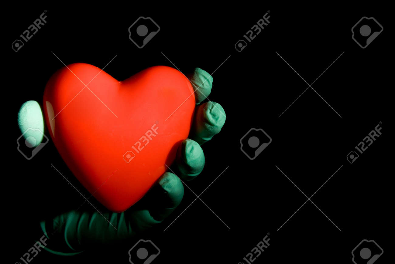 A medical professional holding a red heart. Stock Photo - 3747654