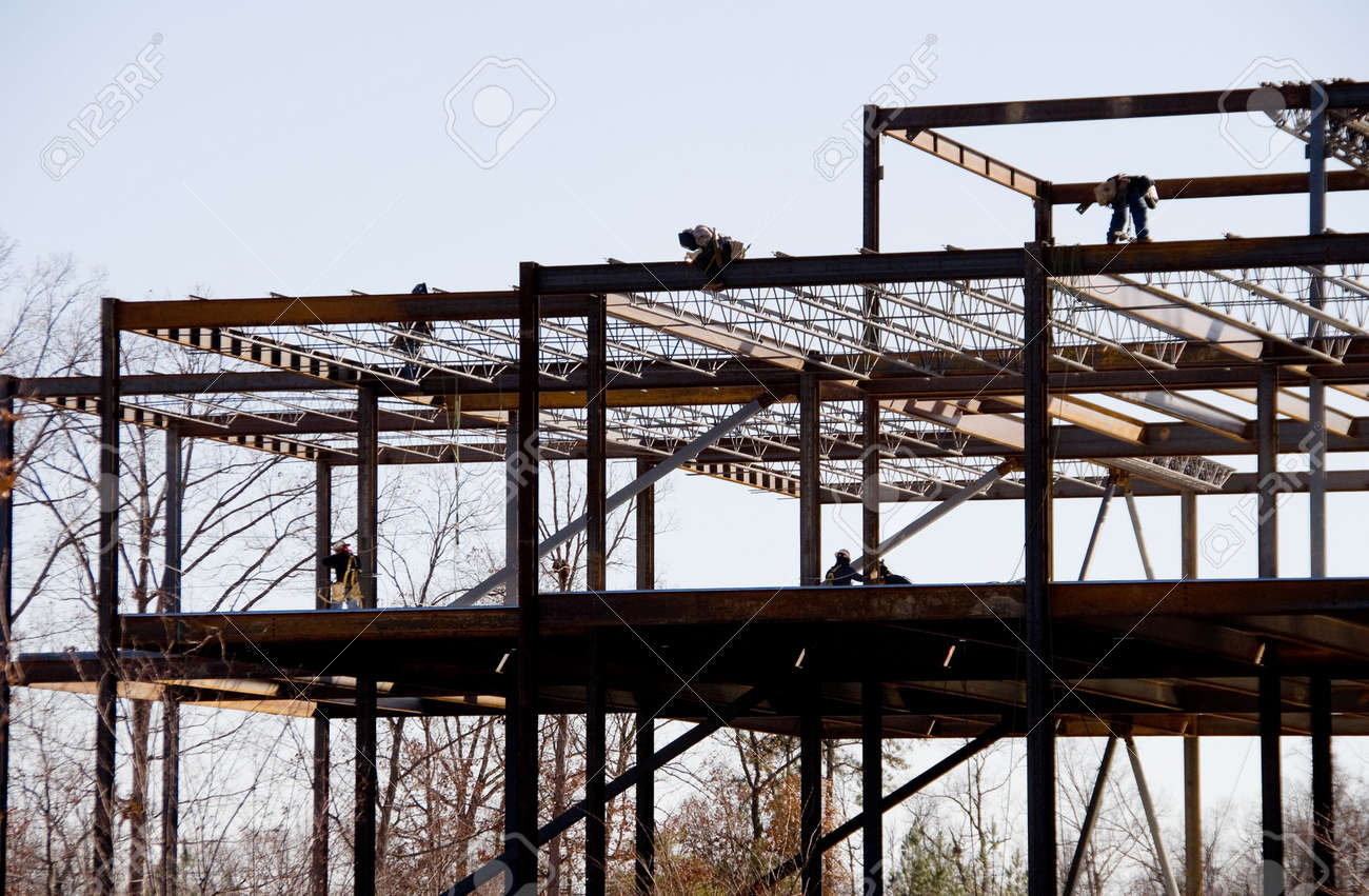 construction workers working on a steel frame building stock photo 3989505