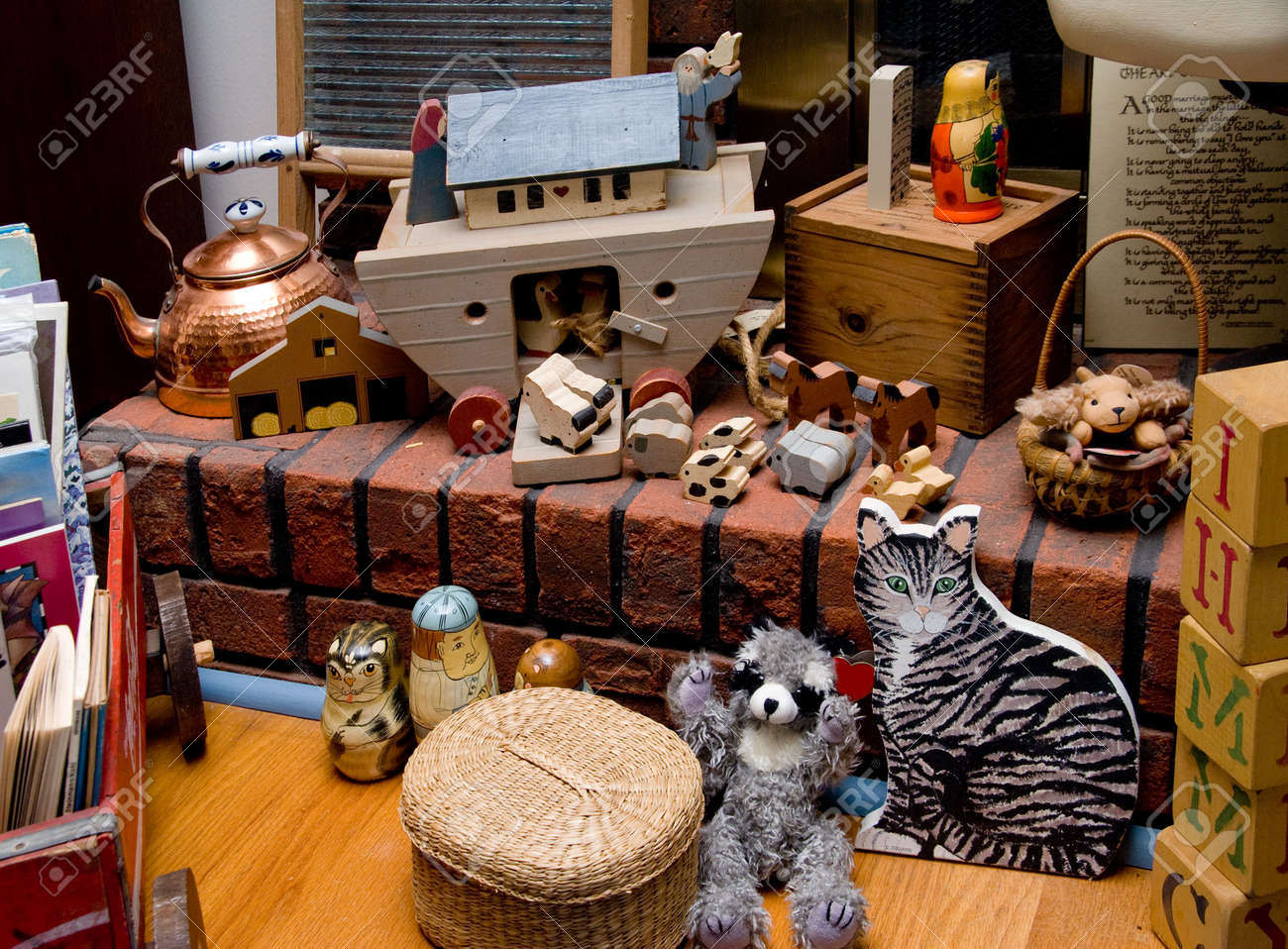 A Collection Of Antique Toys On A Fireplace Hearth. Stock Photo ...