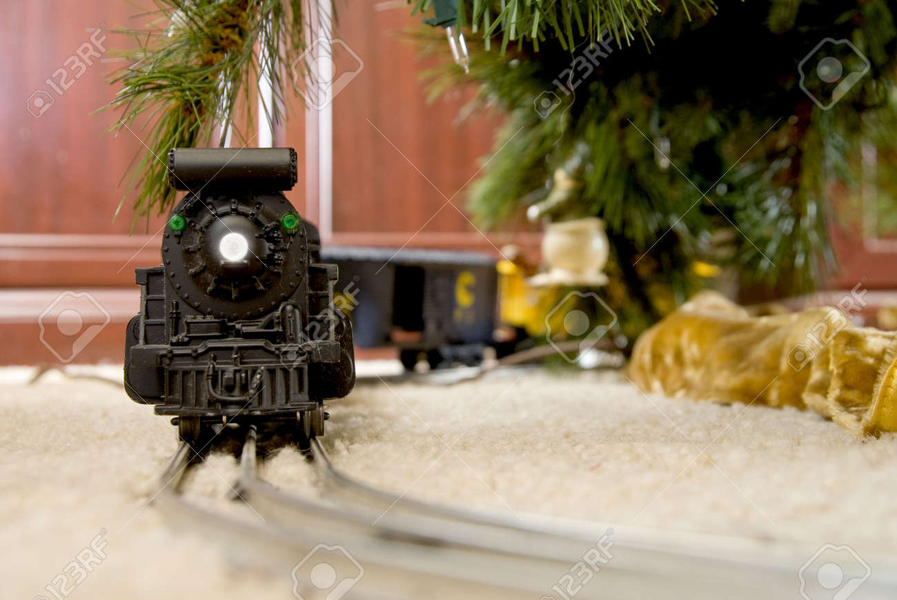 A Model Train On A Track Under A Christmas Tree Stock Photo  - Christmas Trains For Under The Tree