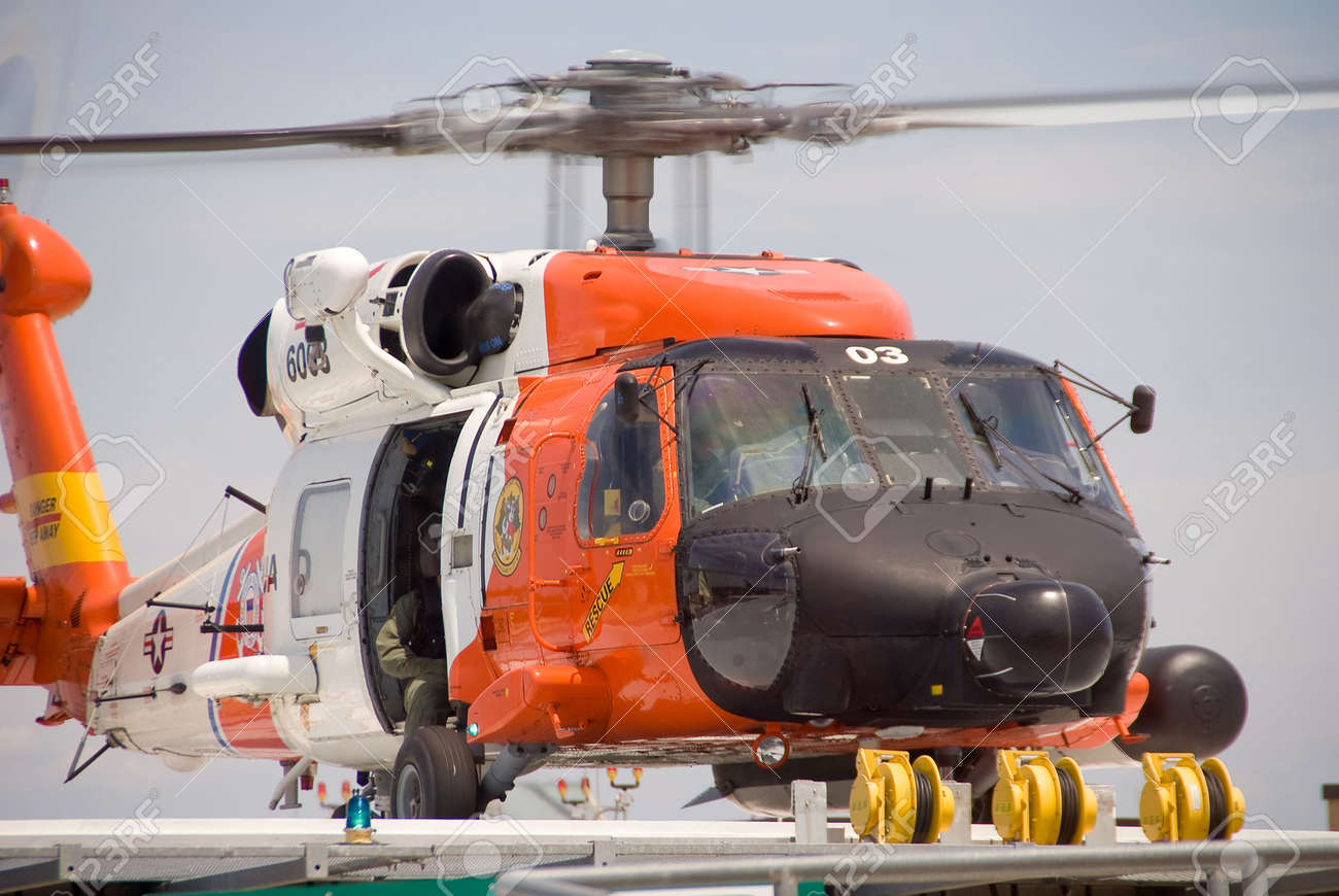 A white and orange Coast Guard Jayhawk Rescue Helicopter