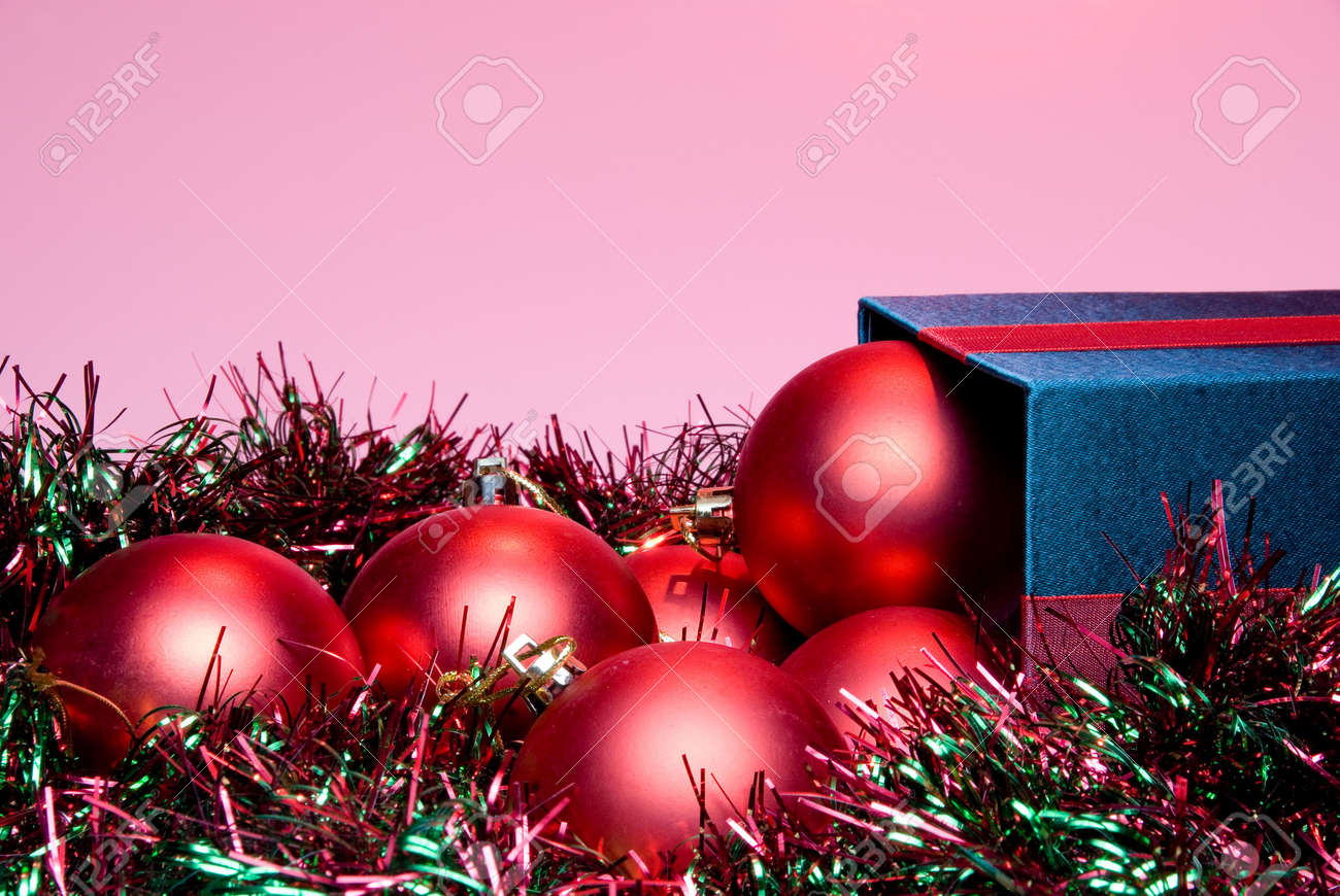 Christmas Ornaments spilling out of a gift box. Stock Photo - 5452069
