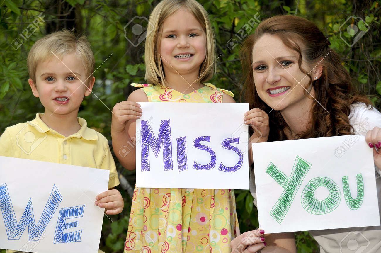A single mom and her son and daughter holding signs Stock Photo - 6915474