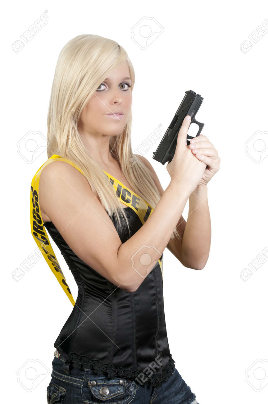 Ayoung and beautiful woman holding a handgun Stock Photo - 7347799