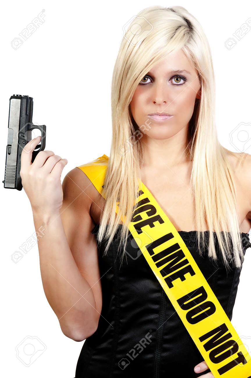 Ayoung and beautiful woman holding a handgun Stock Photo - 7383750