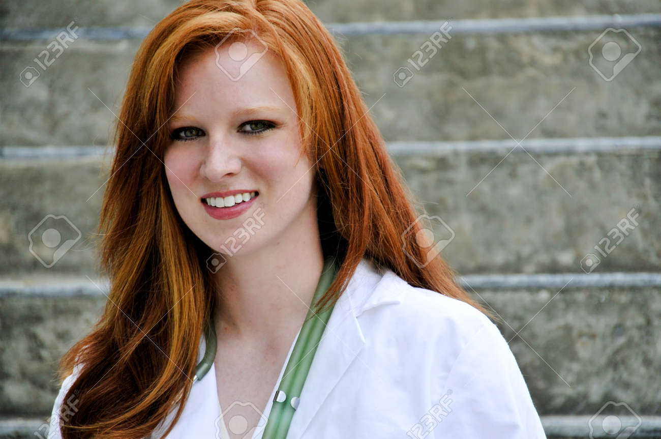 A beautiful young female doctor on her rounds Stock Photo - 7956639